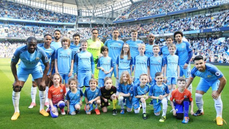 WIN: Be part of the team photo before the Manchester derby.