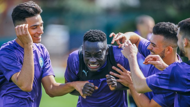 CENTRE OF ATTENTION: Alpha Dionkou is mobbed by his team-mates