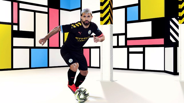 ACTION STATIONS: Sergio Aguero is all revved up in City's new 2019-10 PUMA away kit