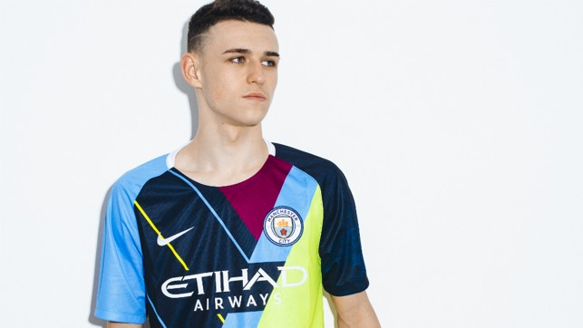 BRIGHT YOUNG THING: Phil Foden proudly sports our celebration mashup shirt