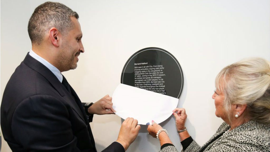 INFLUENCE WRIT LARGE: The chairman and Karen Halford unveil an inscription detailing Bernard's incredible impact on Manchester City