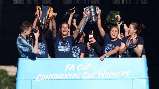DOUBLE WINNERS: Our women's team bus led the procession, showcasing their double success - the Continental Cup and FA Women's Cups!