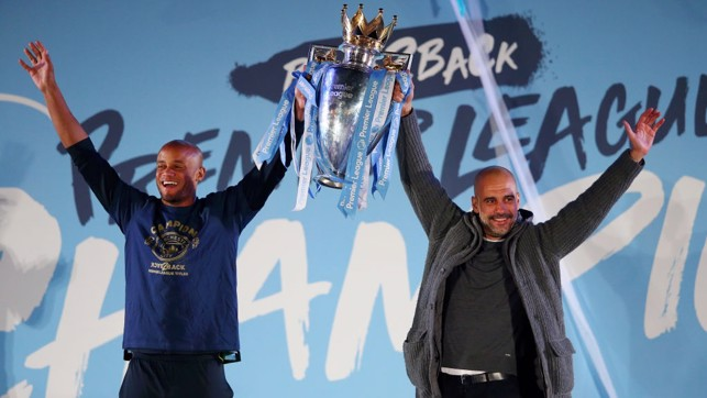 FOR EVERY OCCASION: The boss lifts the Premier League trophy... in his cardigan