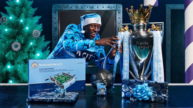 MINE: Benjamin Mendy makes a move for the Premier League trophy.