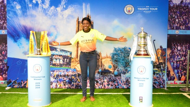 DOUBLE DELIGHT: With our women's team's Continental Cup and FA Cup trophies in Nigeria.