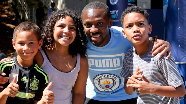 JUNIOR BLUES: Big smiles from Shaun Wright-Phillips and some young fans in Brazil.