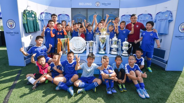 TROPHY LADEN: A photo to treasure for a group of Beijing youngsters.