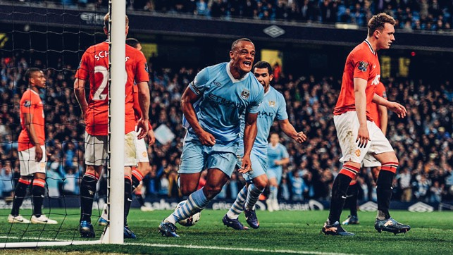 DERBY DELIGHT: Vincent Kompany's face says it all as he crashed home a winner that sent us top of the league on goal difference with two games of the 2011/12 season left to play.