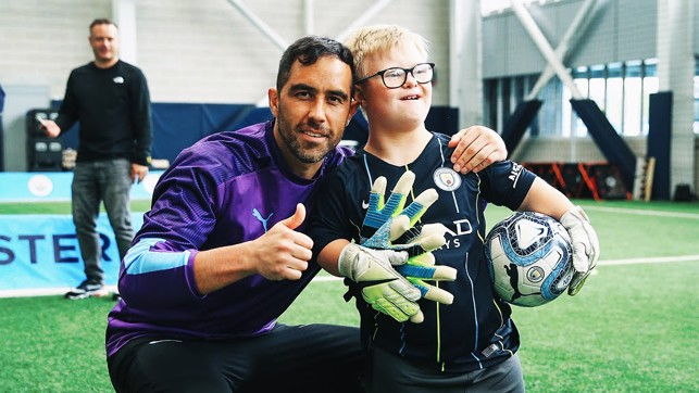 KEEPERS: Claudio Bravo poses with a One City participant.