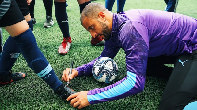 AUTOGRAPH TIME: Kyle Walker makes those boots extra special!