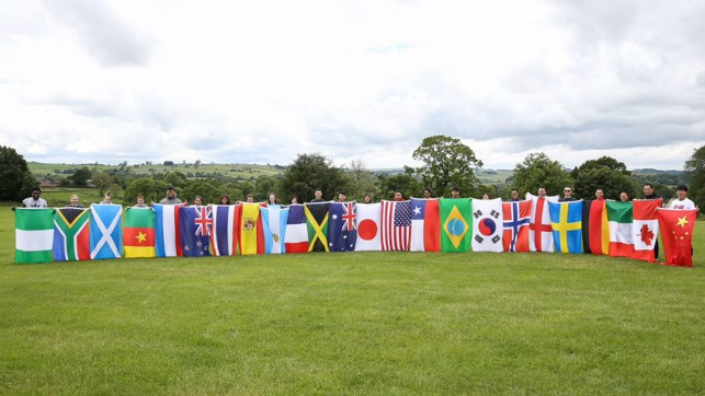 WORLD CUP READY: The Young Leaders display flags of teams participating in the Women's World Cup