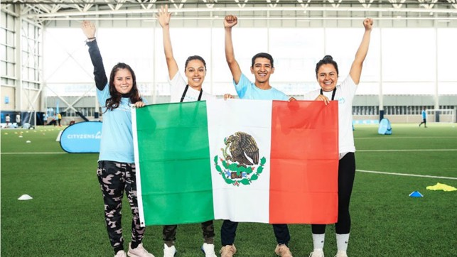 VIVA MEXICO – Our Mexican Young Leaders pose for a photo with their country's flag.
