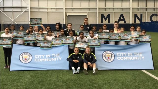 HELPING HAND: Manchester City's Jill Scott, Georgia Stanway and Lauren Hemp assist at a City Girls session.