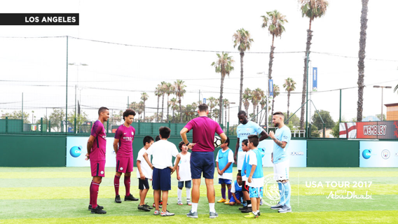 GOALS: Kids being coached by the players