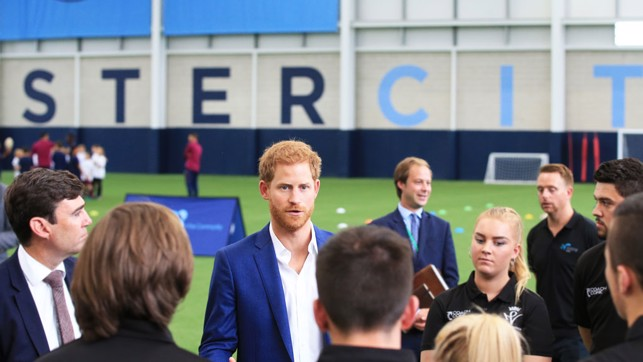 HRH Prince Harry and Mayor of Greater Manchester Andy Burnham discuss coach core programme with apprentices