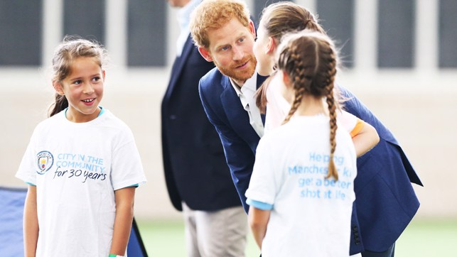 HRH Prince Harry talks to aspiring footballers from the local community