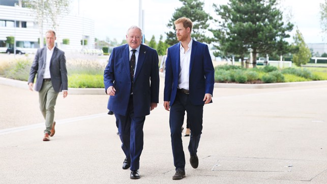 HRH Prince Harry and Paul Griffiths, Vice Lord-Lieutenant of Greater Manchester walk across Etihad Campus