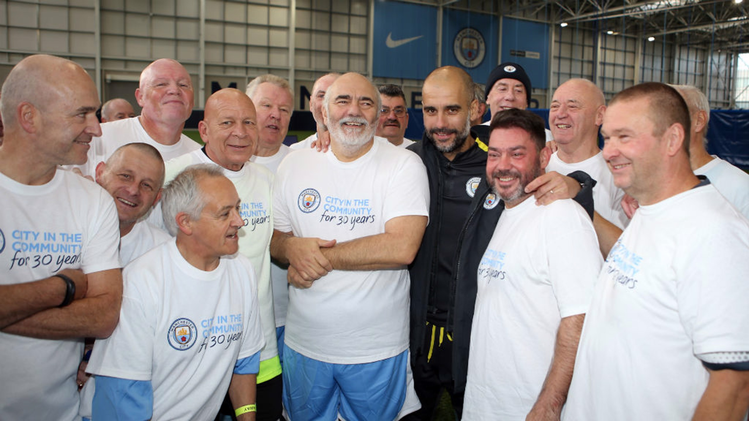 WALKING FOOTBALL: Man City manager Pep Guardiola with the walking football players