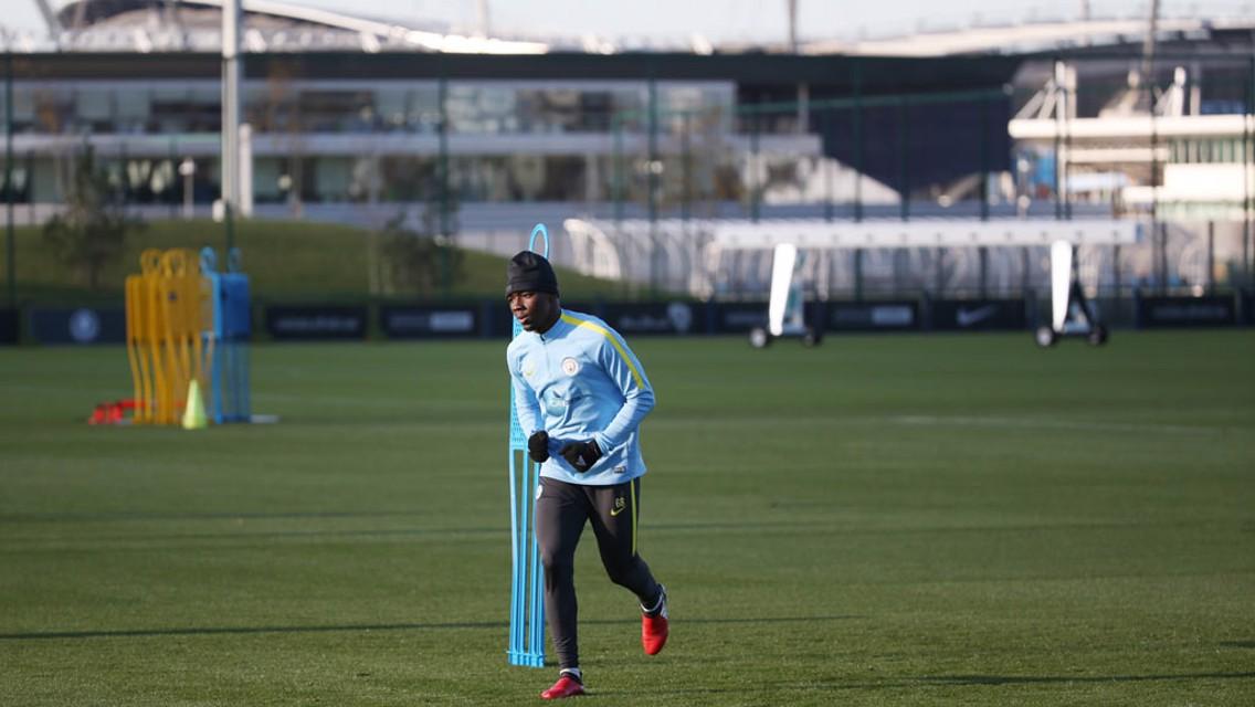 LONG SHOT: Ambrose with a City Football Academy backdrop