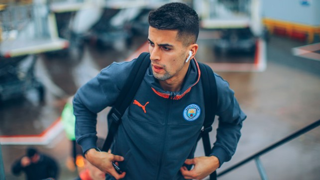 UP AND AT 'EM: Joao Cancelo boards the plane bound for Zagreb