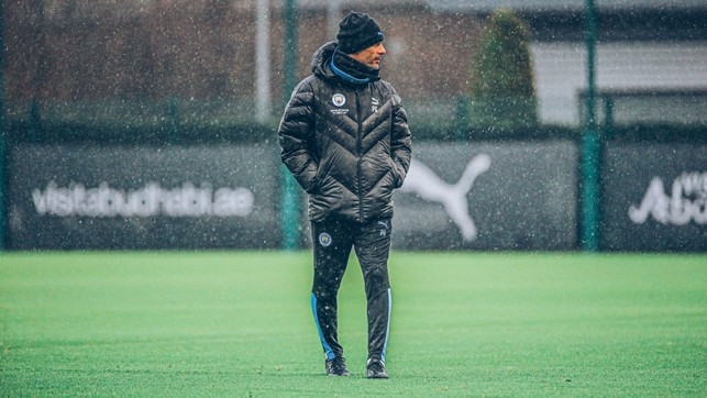 ONE PEP AT A TIME: The boss looks on at a rainy CFA