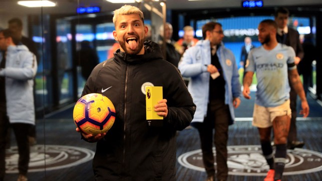 PRIZE GUY: Kun clutches the match ball and man of the match award after his second treble in a week - this time against Chelsea, seven days on from his Etihad exploits against Arsenal