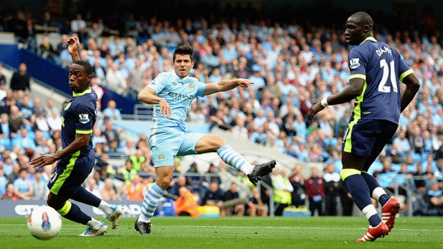 UP AND RUNNING: Sergio Aguero slams home his first hat-trick for the Club against Wigan in 2011