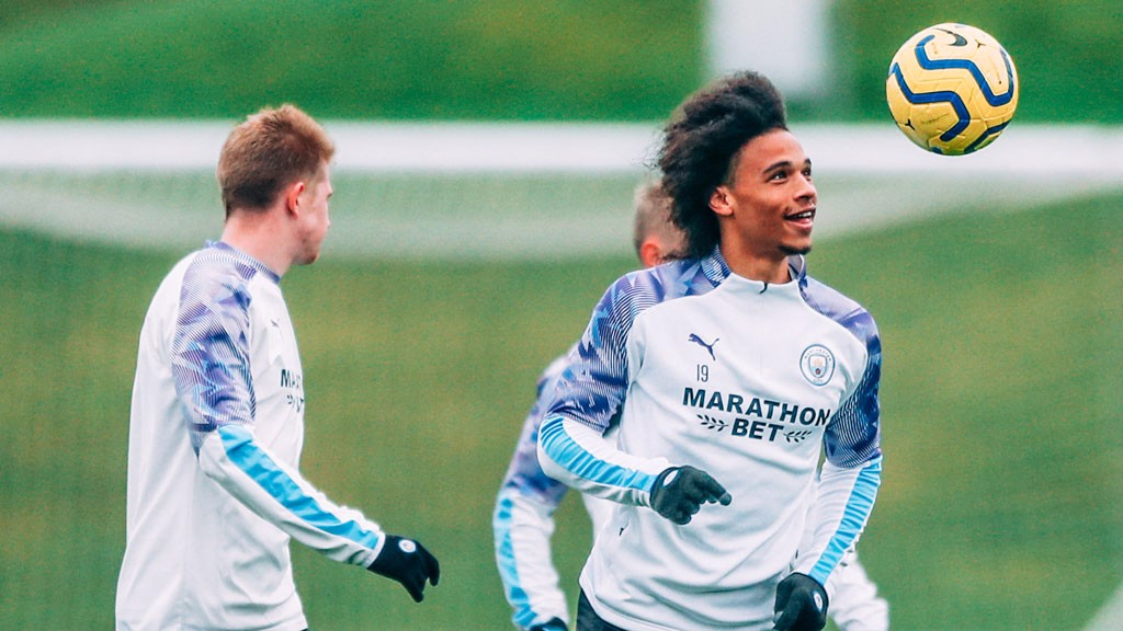 HEAD BOY: Leroy Sane hunts down the ball