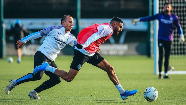 CATCH ME IF YOU CAN: Mahrez looks to shrug off Angelino.
