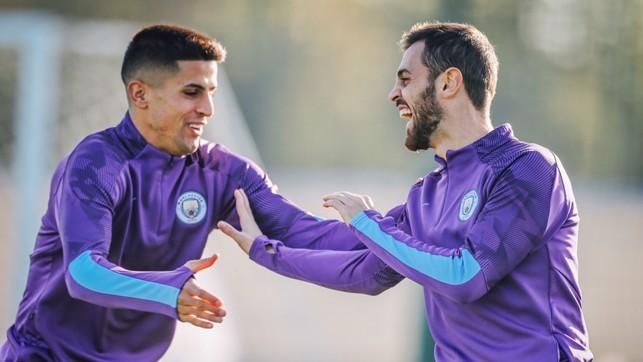 PORTUGUESE PALS: Joao Cancelo and Bernardo Silva share a joke