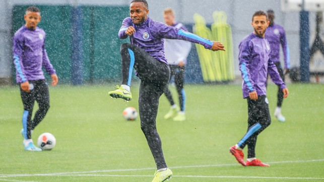 RAINY CITY: The lads get soaked during a downpour