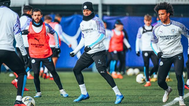 THREE CHEERS: Bernardo Silva, Gabriel Jesus and Leroy Sane limber up in Tuesday's training session
