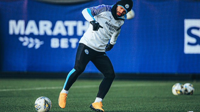 GLOVE STORY: Sergio Aguero was well kitted out to combat the winter chill