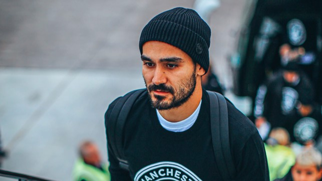 HATS THE WAY TO DO IT: Ilkay Gundogan had his game face on he boarded the plane