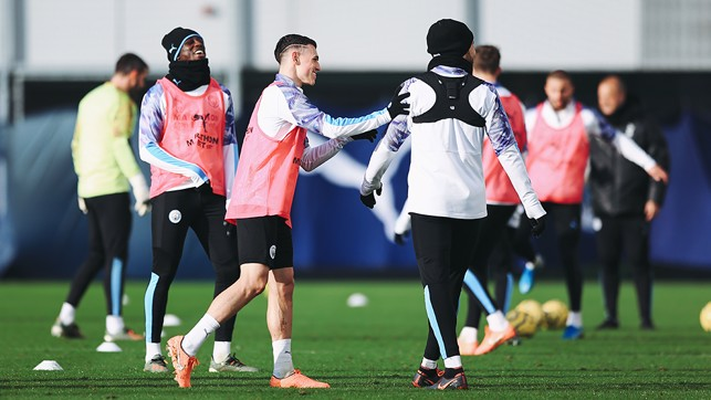 PHIL-ANTHROPY: Phil Foden shares a joke with his teammates