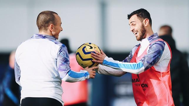 HERE YOU GO: Bernardo Silva quite literally hands possession to Angelino!