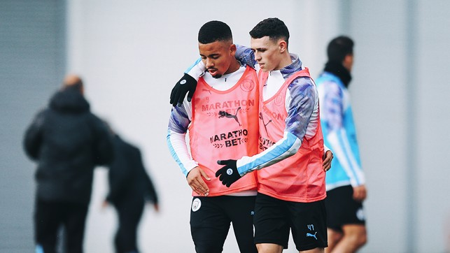 PHILLING IN THE GABS: An arm round the shoulder for Phil Foden and Gabriel Jesus