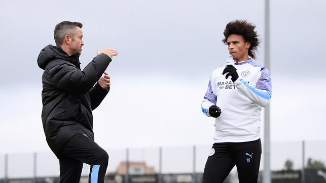 RECOVERY REPORT: Leroy gets advice during his latest session from Donough Holohan, City's sports science strength and conditioning coach