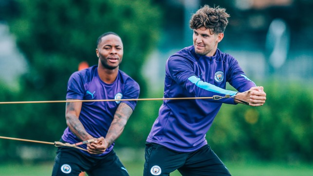 PULL TOGETHER: Raheem and John Stones