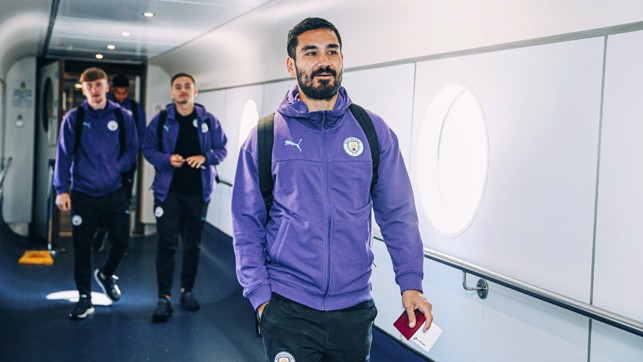 SILKY ILKAY: Gundogan looks cool as you like as he prepares to take his seat on the flight