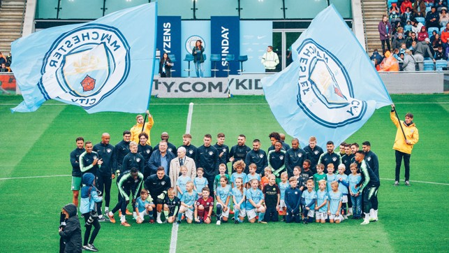 CITYZENS: A group of lucky fans got the chance to join the players for a team photograph