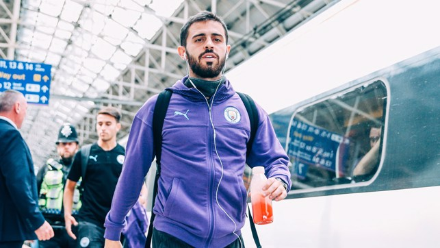 PURPLE REIGN: Bernardo Silva is a study in focus as the City squad board the train to Euston