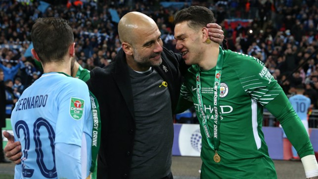 SILVERWARE: Ederson with Pep Guardiola and Bernardo after the Carabao Cup win