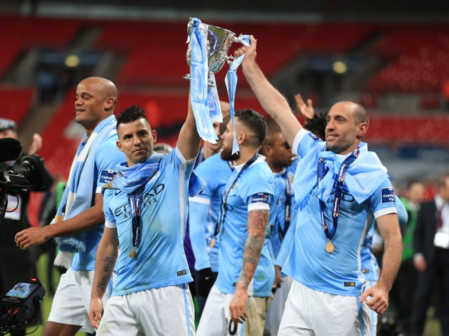 GET IN: Aguero celebrates the Capital One Cup win with Pablo Zabaleta