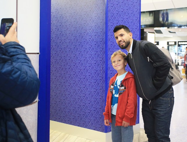 POSE: Aguero poses for a fan at Manchester Airport