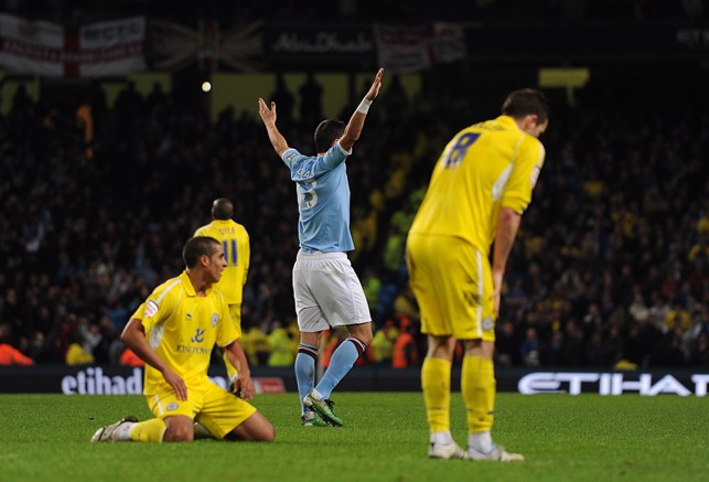 GET IN: Kolarov celebrates after scoring his first goal for City in 2011