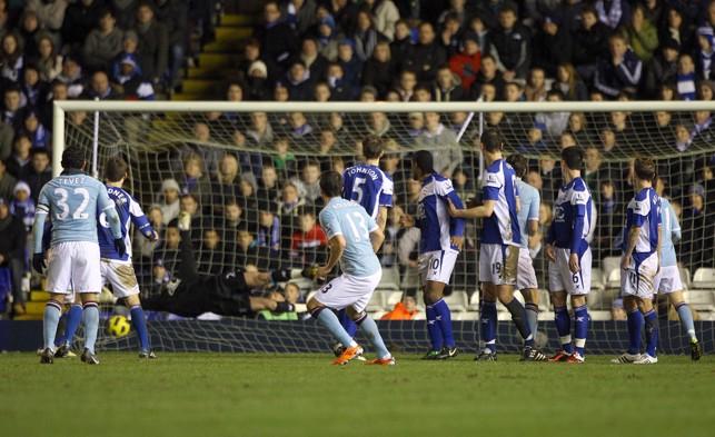 FREE-KICK: Kolarov watches on as he scores his first Premier League goal in 2011