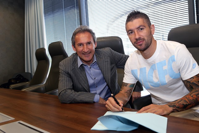 PEN TO PAPER: Kolarov earned a new contract in 2014