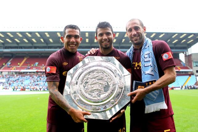 BROTHERS: Argentinian trio Carlos Tevez, Sergio Aguero and Zabaleta lift the Community Shield in 2012