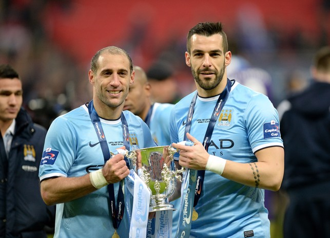 SAY CHEESE: Zabaleta and Alvaro Negredo pose for a photo after winning the League Cup in 2014